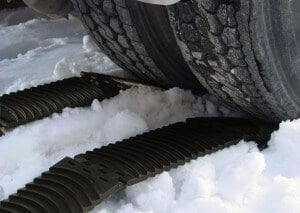 Traction for large trucks stuck in snow, sand, or mud.